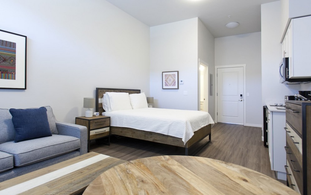 bedroom with large open space on wood-style flooring
