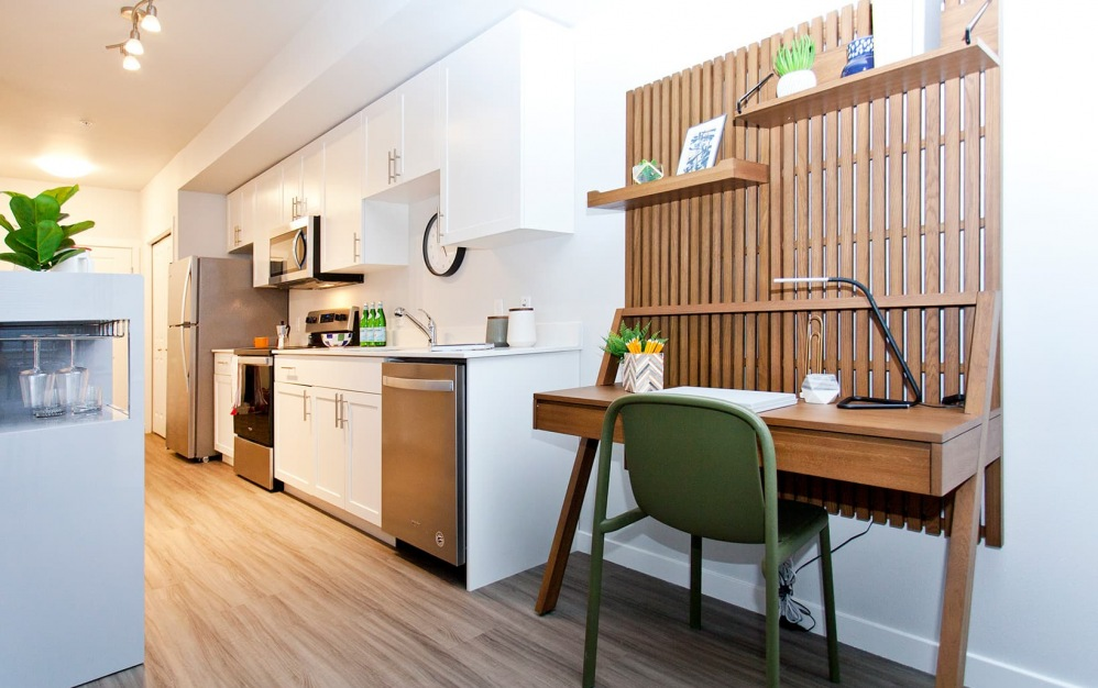 spacious kitchen and desk area